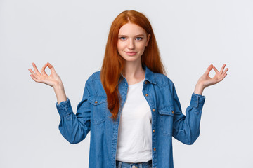 Waist-up portrait confident and relieved, patient good-looking redhead woman calm down daily yoga...