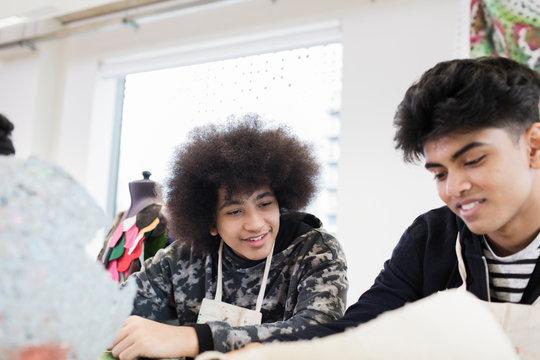 Teenage boys in high school art class