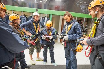 Zip line instructor and students preparing equipment