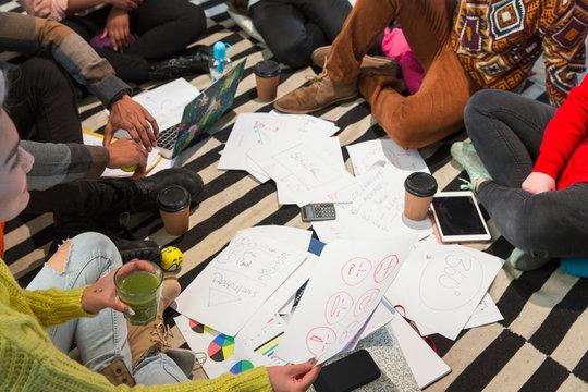 Creative business people meeting, brainstorming in circle on floor