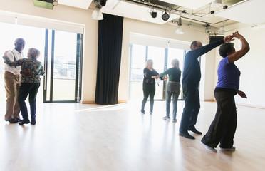 Active seniors dancing in dance class