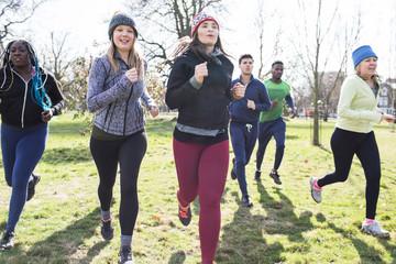 Runners running sunny park