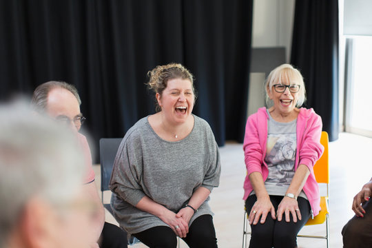 Women laughing in community center