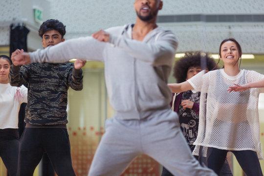 Dancers dancing in dance class studio
