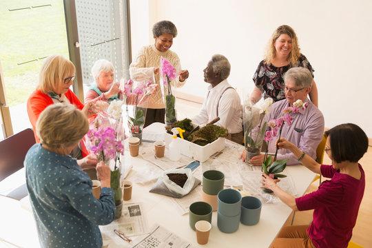Active seniors enjoying flower arranging class