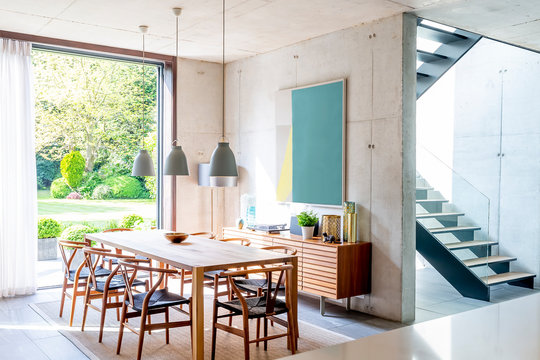 Pendant lights over dining table in modern dining room