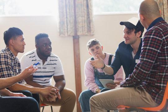 Men talking n group therapy circle