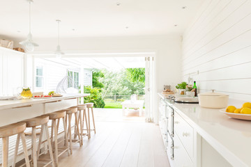 Simple white home showcase interior kitchen open to patio