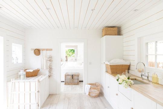 White wood shiplap home showcase laundry room