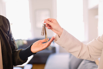 Real estate agent giving keys to homeowner