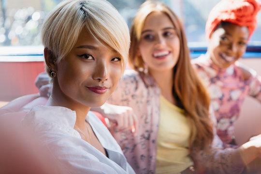 Portrait confident young women friends taking selfie