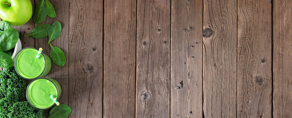 Banner with healthy green smoothie side border. Top view over a rustic wood background with copy space.