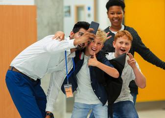 Junior high boy students male teacher taking selfie with smart phone
