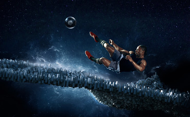 Male soccer player kicking soccer ball against futuristic background