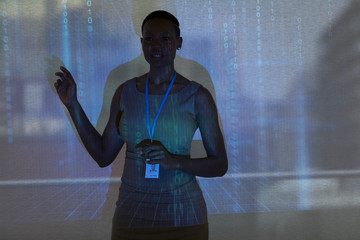 Businesswoman leading meeting at projection screen with binary code