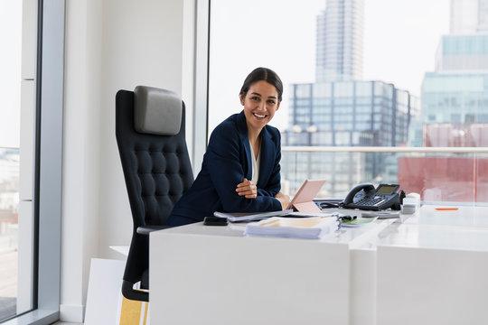 Portrait confident businesswoman working in urban office