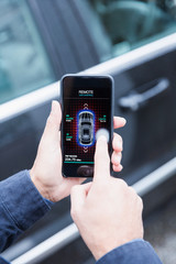 Personal perspective man setting car alarm from smart phone