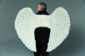 Serene man wearing angel wings