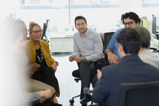 Business people meeting in a circle in office
