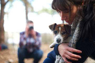 Woman hugging cute puppy dog