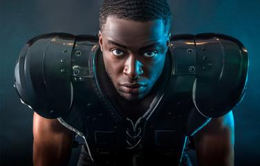 Portrait confident, tough football player wearing pads