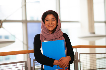 Portrait smiling, confident young female college student wearing hijab