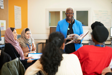Female teacher and multi-ethnic students in classroom