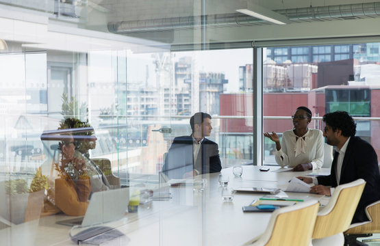 Business people talking in urban conference room meeting