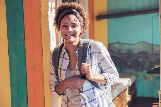 Portrait smiling, confident young woman on sunny patio
