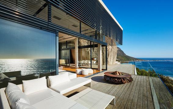 Modern luxury beach house patio with sunny ocean view