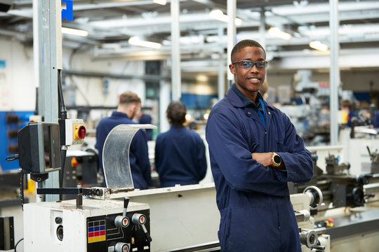 Portrait confident teenage boy student in shop class