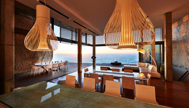 Pendant lights hanging in modern luxury house with ocean view