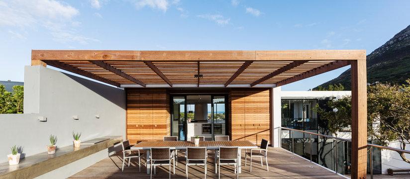 Sunny modern, luxury home showcase exterior patio