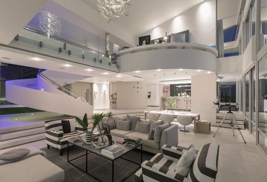 Illuminated modern luxury home showcase interior open plan