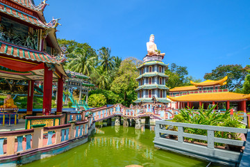 Chinese Pagoda and Pavilion by the Lake at Haw Par Villa Theme Park. This park has statues and dioramas scenes from Chinese mythology, folklore, legends, and history.