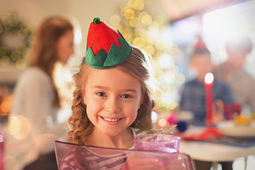 Portrait smiling girl wearing Christmas paper crown