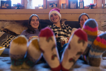 Portrait happy family in colorful socks relaxing in Christmas living room