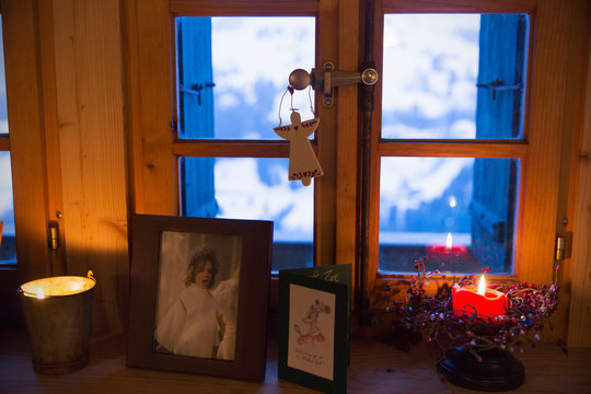 Christmas decorations and candle on  windowsill