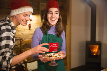 Brother and sister with Christmas cookies