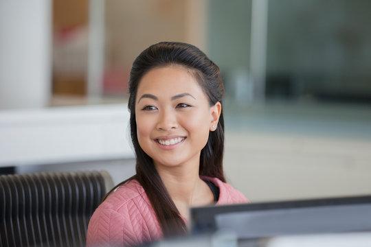 Portrait smiling, confident businesswoman in office