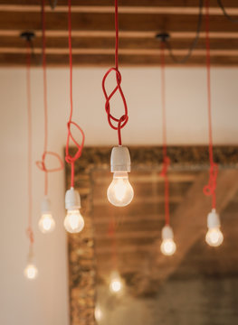 Knotted cord hanging light bulbs
