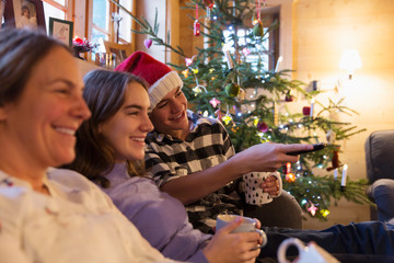 Family relaxing, watching TV in Christmas living room