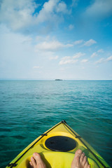 Personal perspective man kayaking on tranquil ocean, Maldives, Indian Ocean