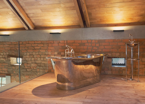 Home showcase interior stainless steel bathtub in loft bathroom