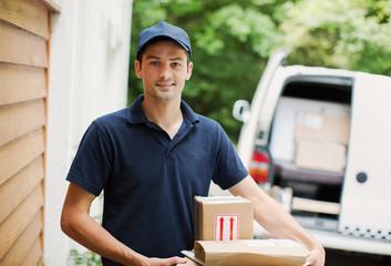 Portrait deliveryman at front door