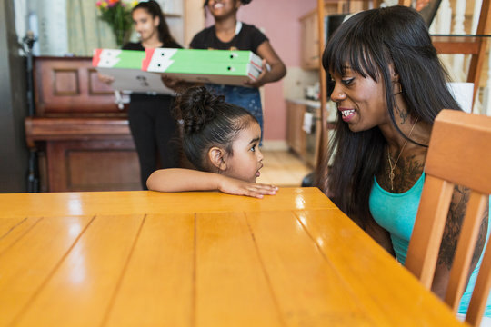 Mother and toddler daughter in dining room