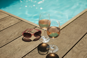 Rose wine at sunny poolside