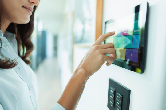Close up woman at home automation touch screen panel