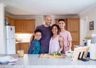 Portrait smiling family cooking in kitchen