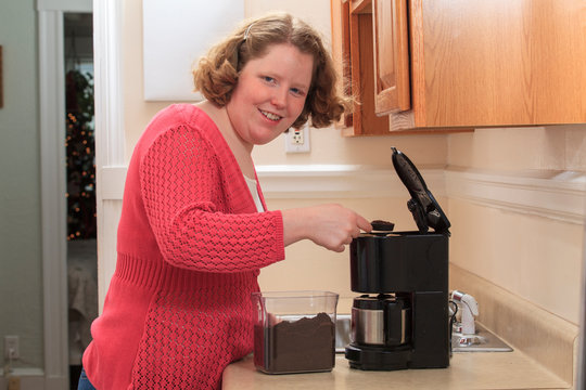 Young woman with Autism making coffee